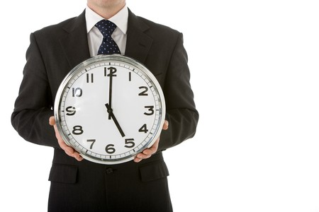 Businessman Holding Clock Stock Photo - 4444457