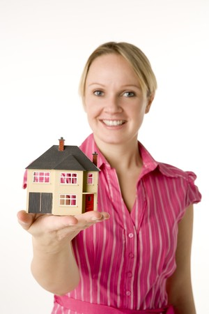 Businesswoman Holding Small House  photo