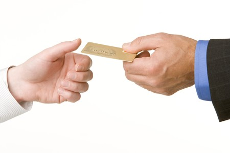 to another: Businessmen Passing Another A Gold Credit Card