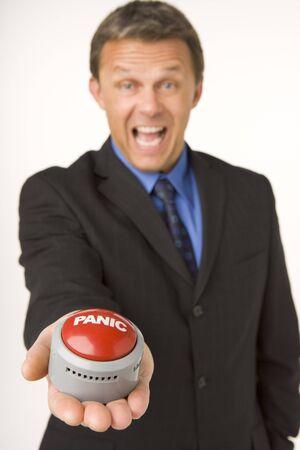 panic button: Imprenditore Holding A Panic Button  Archivio Fotografico