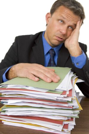 Businessman Overwhelmed By Paperwork photo