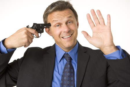 holding gun to head: Businessman Holding Gun To His Head While Smiling And Waving