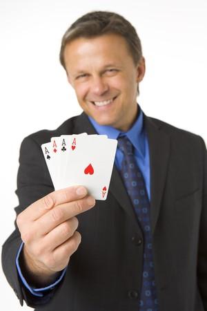 Businessman Holding Four Aces Stock Photo - 4444558