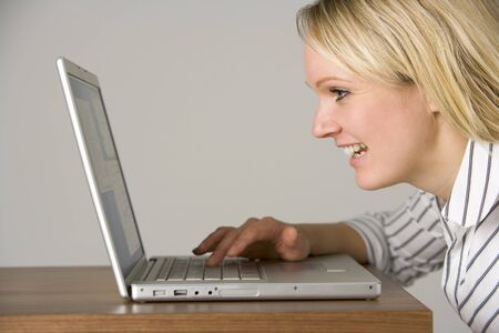 Businesswoman Looking At Laptop  photo