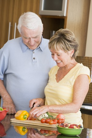 Husband And Wife Preparing Vegetables Stock Photo - 4446414
