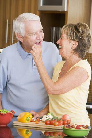 Husband And Wife Preparing Vegetables photo
