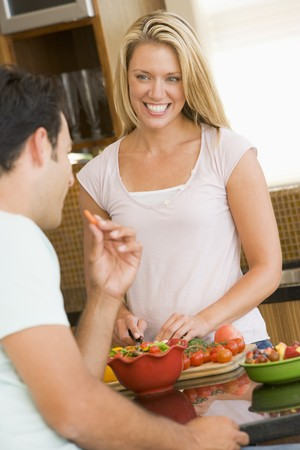 Husband And Wife Preparing Dinner photo