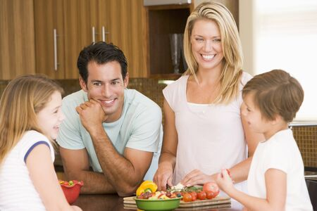 Family Preparing meal,mealtime Together Stock Photo - 4445590