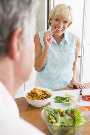 Woman Talking To Husband As She Prepares A meal,mealtime photo