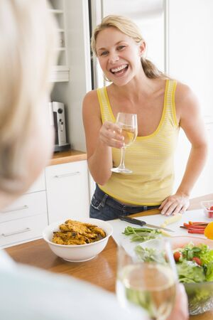 30s thirties: Woman Talking To Friend While Preparing meal,mealtime