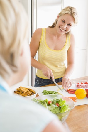 mealtime: Woman Talking To Friend While Preparing meal,mealtime