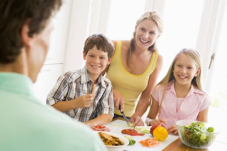 Family Preparing meal,mealtime Together Stock Photo - 4445300