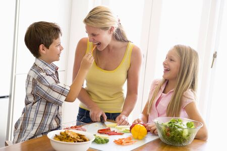 Mother And Children Prepare A meal,mealtime Together  photo