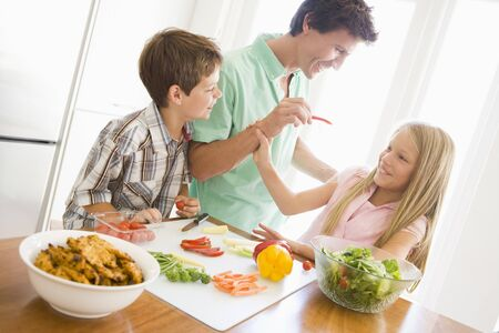 mealtime: Father And Children Prepare A meal,mealtime Together