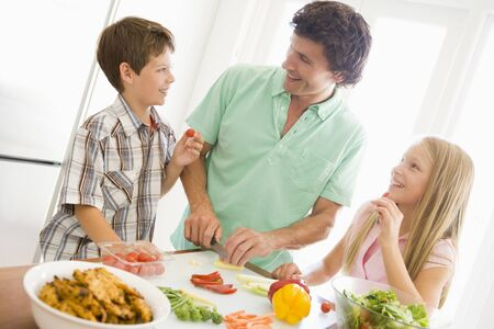 Father And Children Prepare A meal,mealtime Together  Stock Photo - 4445891