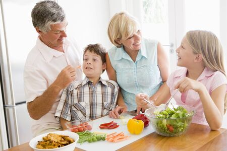 mealtime: Grandparents And Grandchildren Prepare A meal,mealtime Together  Stock Photo