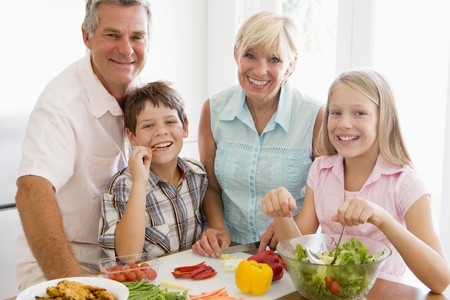 Grandparents And Grandchildren Prepare A meal,mealtime Together Stock Photo - 4446003