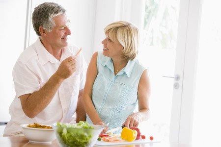 Husband And Wife Preparing meal,mealtime Together Stock Photo - 4444661