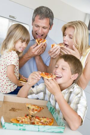Family Eating Pizza Together  photo