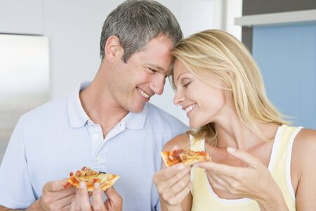 Husband And Wife Eating Pizza photo