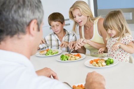 woman eat: Family Eating A meal,mealtime Together