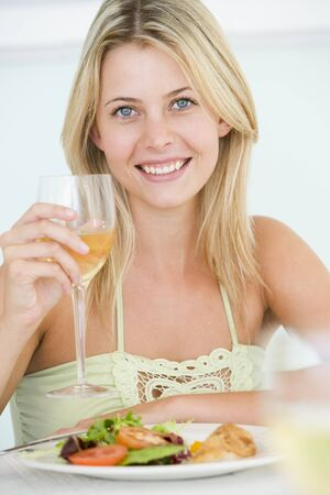 Young Woman Enjoying meal,mealtime With A Glass Of Wine photo