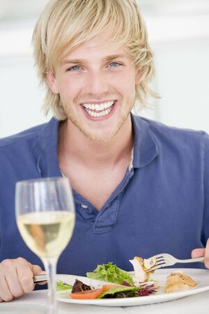 Young Man Enjoying meal,mealtime With A Glass Of Wine photo