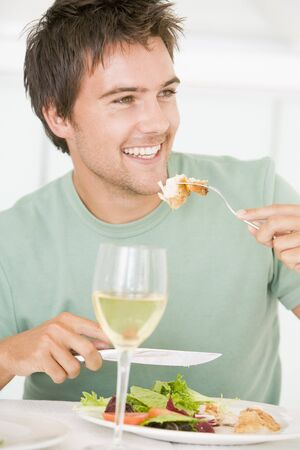 mealtime: Young Man Enjoying meal,mealtime With A Glass Of Wine