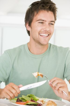 mealtime: Young Man Enjoying Healthy meal,mealtime