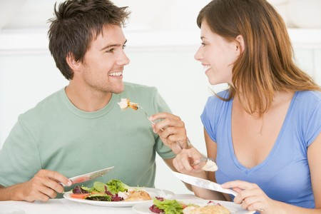 mealtime: Young Couple Enjoying meal,mealtime Together