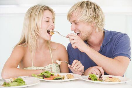 vegetables young couple: Young Couple Enjoying meal,mealtime Together