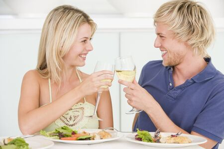 Young Couple Enjoying meal,mealtime With A Glass Of Wine photo