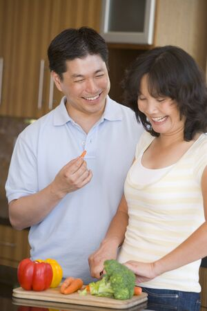 Husband And Wife Preparing meal,mealtime Together photo
