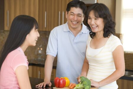 mealtime: Family Laughing While Preparing meal,mealtime