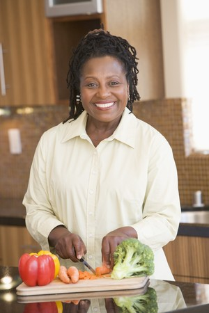 Woman Chopping Vegetables photo