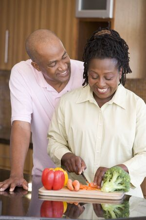 Husband And Wife Preparing A meal,mealtime Together photo