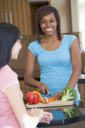 mealtime: Women Laughing With Friend While Preparing meal,mealtime