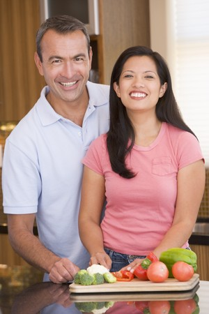 mealtime: Husband And Wife Preparing meal,mealtime Together Stock Photo