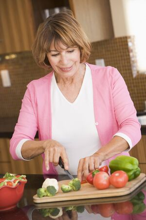 Woman Chopping Vegetables Stock Photo - 4445715