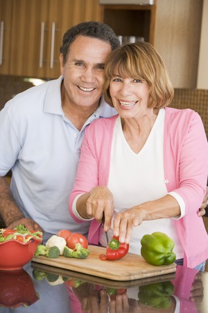 Husband And Wife Preparing meal,mealtime Together Stock Photo - 4445859