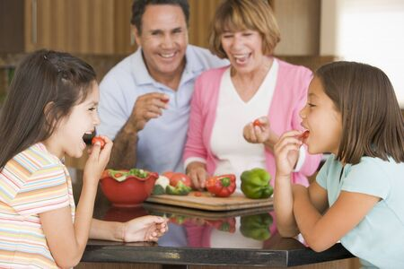 latin food: Family Preparing meal,mealtime Together  Stock Photo