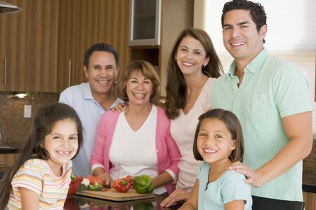 6 7 year old: Family Preparing meal,mealtime Together  Stock Photo