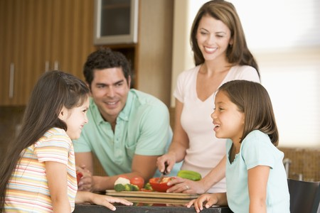 hispanic kids: Family Preparing meal,mealtime Together  Stock Photo
