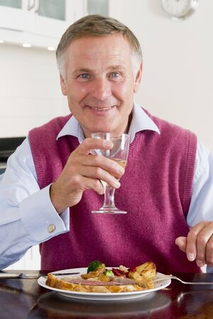 Man Enjoying Healthy meal,mealtime With A Glass Of Wine photo