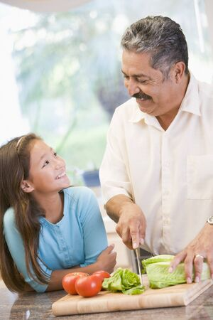 mealtime: Grandfather And Granddaughter Preparing meal,mealtime Together