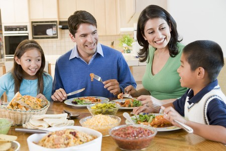 preadolescent: Family Enjoying meal,mealtime Together Stock Photo