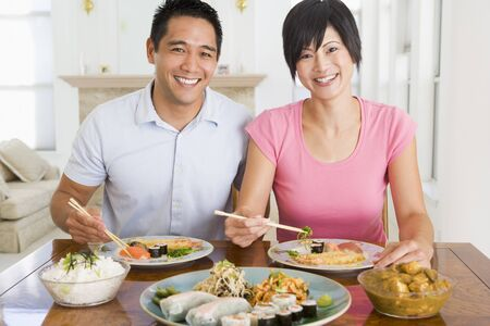 Young Couple Enjoying Chinese Food photo