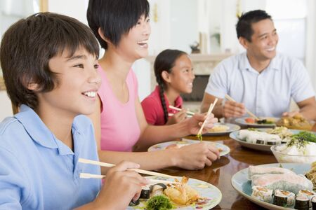 preteen asian: Family Eating A meal,mealtime Together