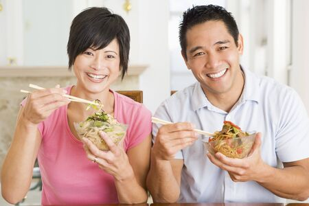 Young Couple Enjoying Chinese Food photo