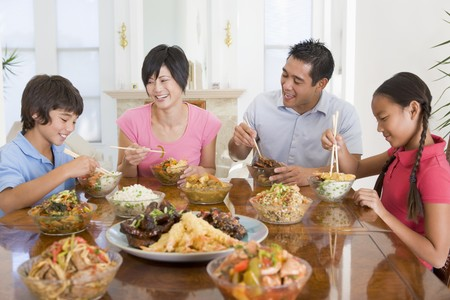 preteen asian: Family Enjoying meal,mealtime Together Stock Photo